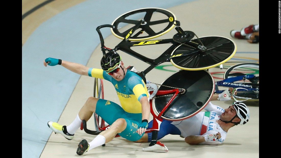 Australia's Glenn O'Shea, left, and Italy's Elia Viviani crash Monday, August 15, during the points race portion of the omnium track-cycling event. Viviani still won gold.