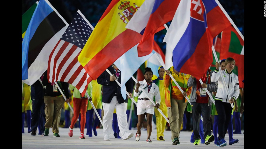 "Gymnast <a href=""http://www.cnn.com/2016/08/20/health/simone-biles-role-model-cliff-jumper/"" target=""_blank"">Simone Biles</a>, in the white shorts, carries the American flag during the closing ceremony on Sunday, August 21. Biles, who won gold in both the individual and team all-around, became the first American gymnast to win four gold medals in a single Olympics."