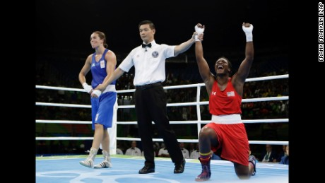 Claressa Maria Shields, right, reacts as she won her gold medal for the women's middleweight 75-kg boxing.