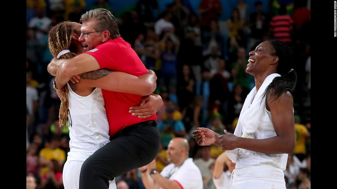 "U.S. basketball player Brittney Griner holds head coach Geno Auriemma after <a href=""http://www.cnn.com/2016/08/20/sport/rio-olympics-womens-basketball-usa-spain-final/"" target=""_blank"">winning the gold-medal game</a> against Spain on Saturday, August 20. It is the sixth straight time that the U.S. women have won Olympic gold."