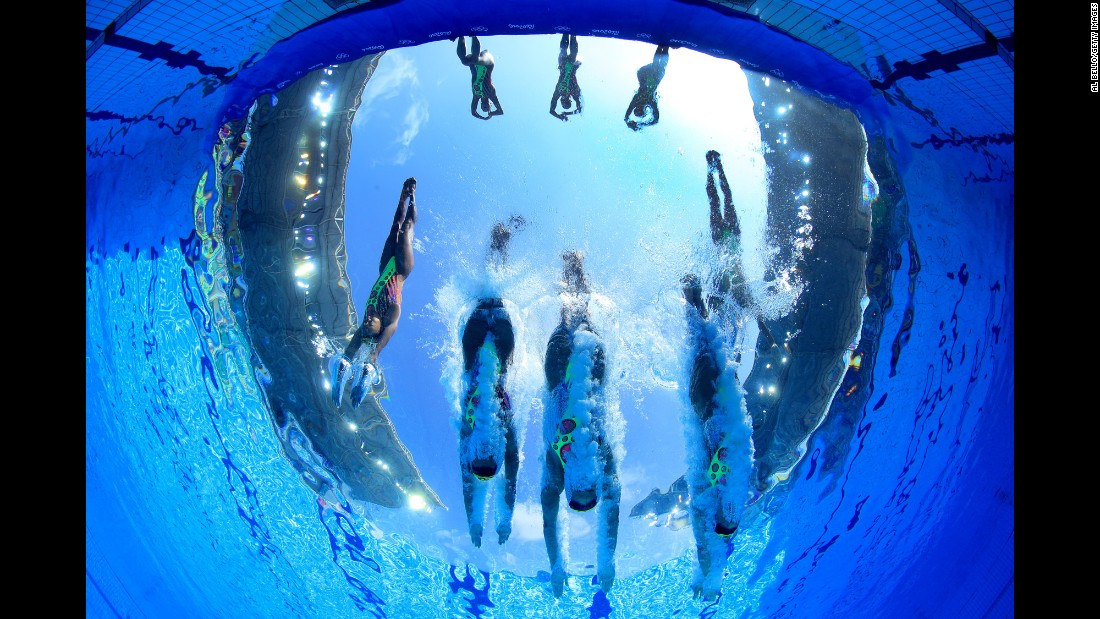 Japan's synchronized swimming team enters the pool for its technical routine on Thursday, August 18.