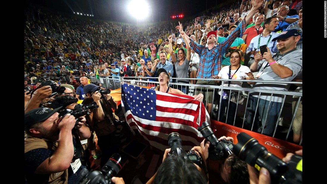 Beach volleyball legend Kerri Walsh Jennings holds the American flag after winning the bronze medal on Wednesday, August 17. She also won gold in 2004, 2008 and 2012.