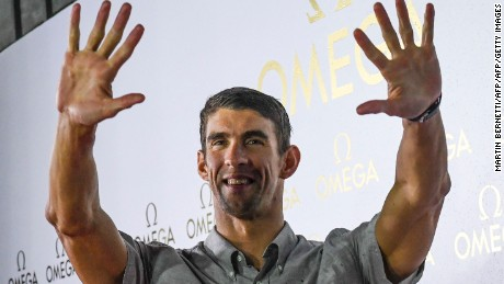 Michael Phelps pose for photographers at an Omega promotional event in  Rio de Janeiro, Brazil, August 15, 2016. AFP PHOTO/ MARTIN BERNETTI Michael Phelps ended his swimming legend's career with 23 Olympic gold medals at the Rio Games. / AFP / Martin BERNETTI        (Photo credit should read MARTIN BERNETTI/AFP/Getty Images)