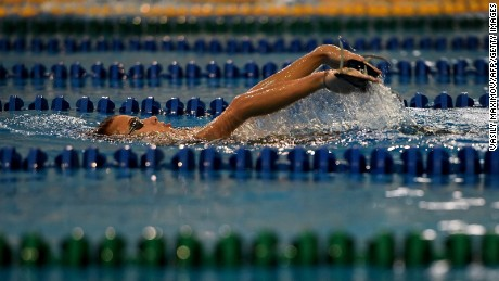 TO GO WITH AFP STORY BY GABRIELLE TETRAULT-FARBER Paralympic swimmer Alexander Makarov, Russia's Paralympic national team, swims during a training session in the town of Ruza, 100 km west of Moscow, on August 18, 2016.  Russian Paralympic hopeful Alexander Makarov, a 19-year-old backstroke specialist, churns through 50 laps during his morning training session outside Moscow, preparing for Games he might have to watch from home. The International Paralympic Committee's decision this month to suspend Russia over evidence of state-sponsored doping has threatened to further tarnish the country's drug-tainted reputation and see all its Paralympians sidelined from Rio. / AFP / VASILY MAXIMOV / TO GO WITH AFP STORY BY GABRIELLE TETRAULT-FARBER        (Photo credit should read VASILY MAXIMOV/AFP/Getty Images)