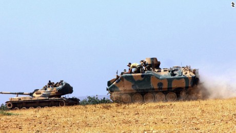 Turkish military vehicles in Karkamis, near the Syrian border Tuesday.