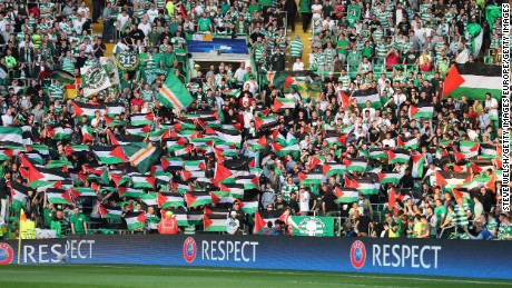 GLASGOW, SCOTLAND - AUGUST 17: Palestinian flags are waved by fans during the UEFA Champions League Play-off First leg match between Celtic and Hapoel Beer-Sheva at Celtic Park on August 17, 2016 in Glasgow, Scotland.  (Photo by Steve Welsh/Getty Images)