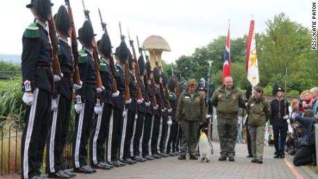 Nils Olav parades down Edinburgh Zoo's Penguin Walk, ending by inspecting the Guard.