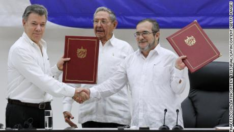 "HAVANA, CUBA - JUNE 23:  Juan Manuel Santos president of Colombia (L) and Timoleon Jimenez ""Timonchenko"" shake hands (R) shake hands during a ceremony to sign a historic ceasefire agreement between Colombian Government and the FARC rebels to end a 50-year conflict on June 23, 2016 in Havana, Cuba. Several Latin American leaders were present to mark the end of the last major conflict on the continent.  (Photo by Ernesto Mastrascusa/LatinContent/Getty Images)"