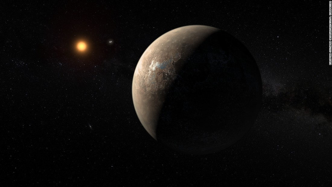 This artist's impression shows the planet Proxima b orbiting the red dwarf star Proxima Centauri, the closest star to our solar system.
