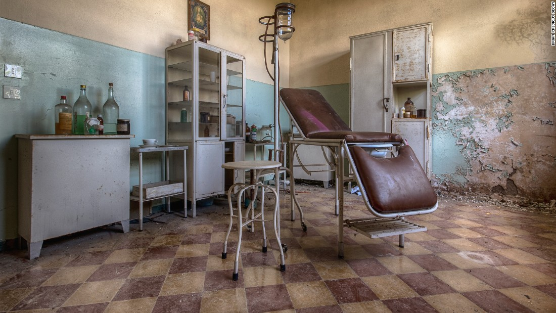 "A check-up room in a former ""children's colony"" in Italy. The home took in poor children during the holidays."