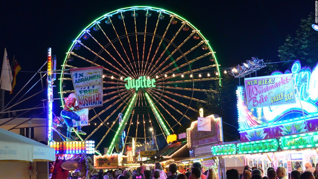 The Jupiter Ferris wheel carries passengers 50 meters up over the festival.