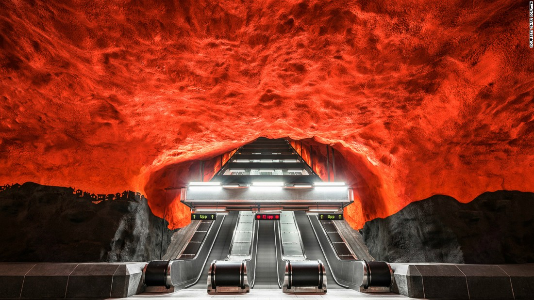 """Stockholm's Tunnelbana is known as the world's longest art exhibit,"" Forsyth explains. ""Many of its stations have kept their raw, cave-like form, and include larger than life hand-painted walls and ceilings."" Pictured: Solna Centrum, Stockholm. <br />"