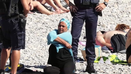 Police confront a woman in a burkini on a beach in Nice last week.