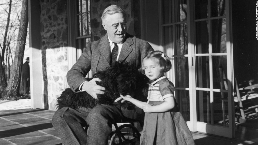 Roosevelt poses with Fala and a friend's granddaughter, Ruthie Bie, at Hill Top Cottage in Hyde Park, New York, around 1940.