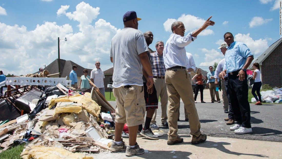 "U.S. President Barack Obama speaks with residents as he <a href=""http://www.cnn.com/2016/08/23/politics/obama-louisiana-tour-criticism/"" target=""_blank"">tours a flood-affected area</a> in Baton Rouge, Louisiana, on Tuesday, August 23. <a href=""http://www.cnn.com/2016/08/18/us/louisiana-flooding/"" target=""_blank"">The Red Cross said</a> the catastrophic flooding is the worst to hit the United States since Hurricane Sandy four years ago."