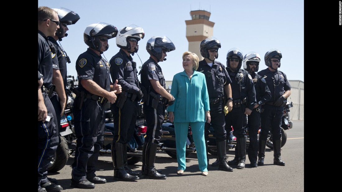 Hillary Clinton, the Democratic presidential nominee, greets law enforcement officers at Reno-Tahoe International Airport in Nevada on Thursday, August 25.