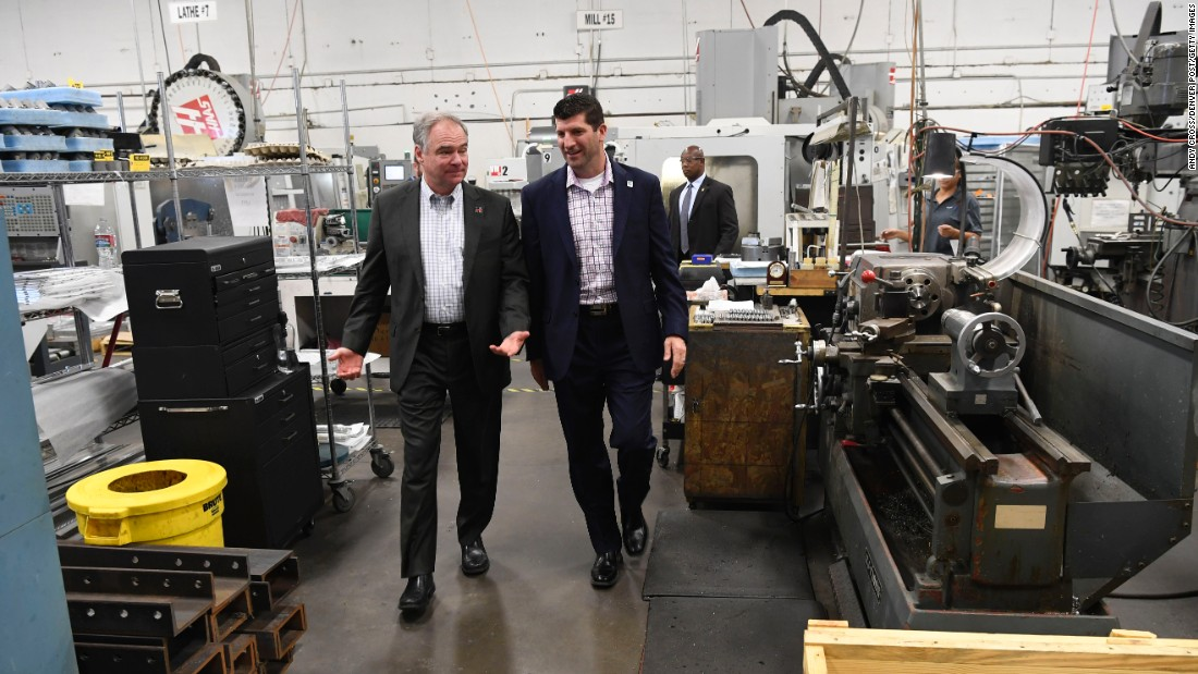 Democratic vice presidential nominee Tim Kaine, left, tours the Primus Aerospace factory with President and Chief Executive Randy Brodsky in Lakewood, Colorado, on Tuesday, August 23.