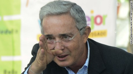 Colombian former president, opposition senator Alvaro Uribe gestures during a forum at the Evigado municipality, Antioquia department, Colombia on June 23, 2016.  Colombia's government and the FARC guerrilla force signed a definitive ceasefire Thursday, taking one of the last crucial steps toward ending Latin America's longest civil war. / AFP / RAUL ARBOLEDA        (Photo credit should read RAUL ARBOLEDA/AFP/Getty Images)