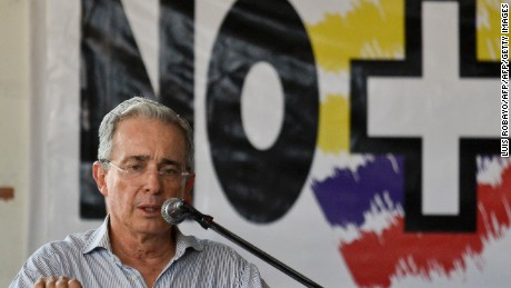 "Colombian former president, senator Alvaro Uribe speaks during a signature protest ""For the Peace We Want"" (Por la Paz Que Queremos) against the peace talks between the Colombian government leaded by President Juan Manuel Santos and the FARC guerrillas in Cali, Colombia, on June 22, 2016.  Colombia's government and the FARC guerrilla force agreed Wednesday on a definitive ceasefire, taking one of the last steps towards ending Latin America's longest civil war. The announcement heralds an end to a half-century conflict that has killed hundreds of thousands of people in the jungles of the major cocaine-producing country. / AFP / LUIS ROBAYO        (Photo credit should read LUIS ROBAYO/AFP/Getty Images)"