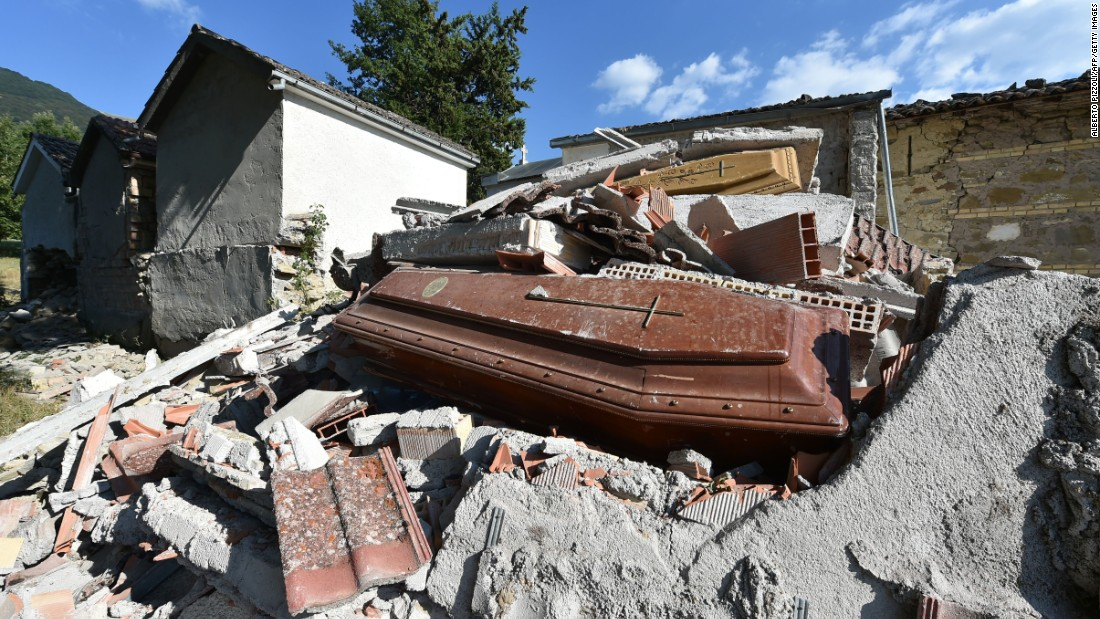 Damaged coffins and rubble are seen at the cemetery of Sant'Angelo, Italy, on August 27.
