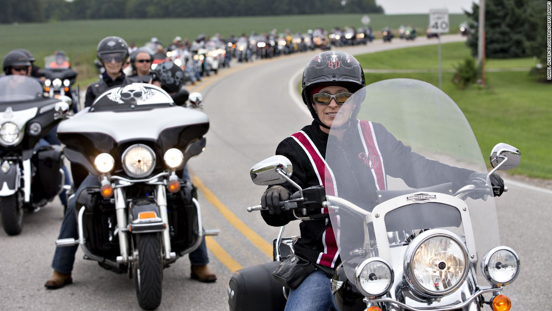 US Sen. Joni Ernst, a Republican from Iowa, right, leads a group of motorcyclists during the second annual Roast and Ride in Des Moines, Iowa, on Saturday, August 27. Ernst, who in 2014 won the Senate seat vacated by Democrat Tom Harkin when he retired, has turned her Roast and Ride into the conservative answer to the Harkin's legendary Steak Fry fundraiser, which auditioned dozens of presidential candidates over its 37-year history.