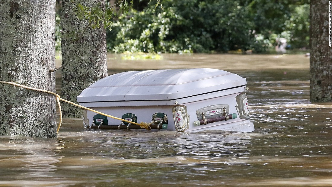 "A casket floats in floodwaters in Ascension Parish, Louisiana, on Monday, August 15. More than 30,000 people were rescued in southern Louisiana after <a href=""http://www.cnn.com/2016/08/13/us/gallery/louisiana-flooding/index.html"" target=""_blank"">heavy rains caused flooding.</a>"
