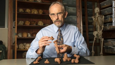 John Kappelman with 3D printouts of Lucy's skeleton.