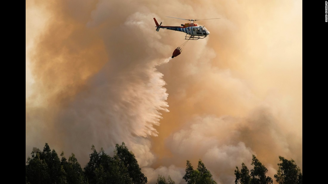 "A firefighting helicopter drops water on a forest fire near Santa Comba Dao, Portugal, on Thursday, August 11. Hot, dry summer weather and treacherous winds have combined to make life difficult for firefighters <a href=""http://www.cnn.com/2016/08/11/europe/europe-france-spain-portugal-wildfires/"" target=""_blank"">battling huge blazes</a> in France, Spain and Portugal."