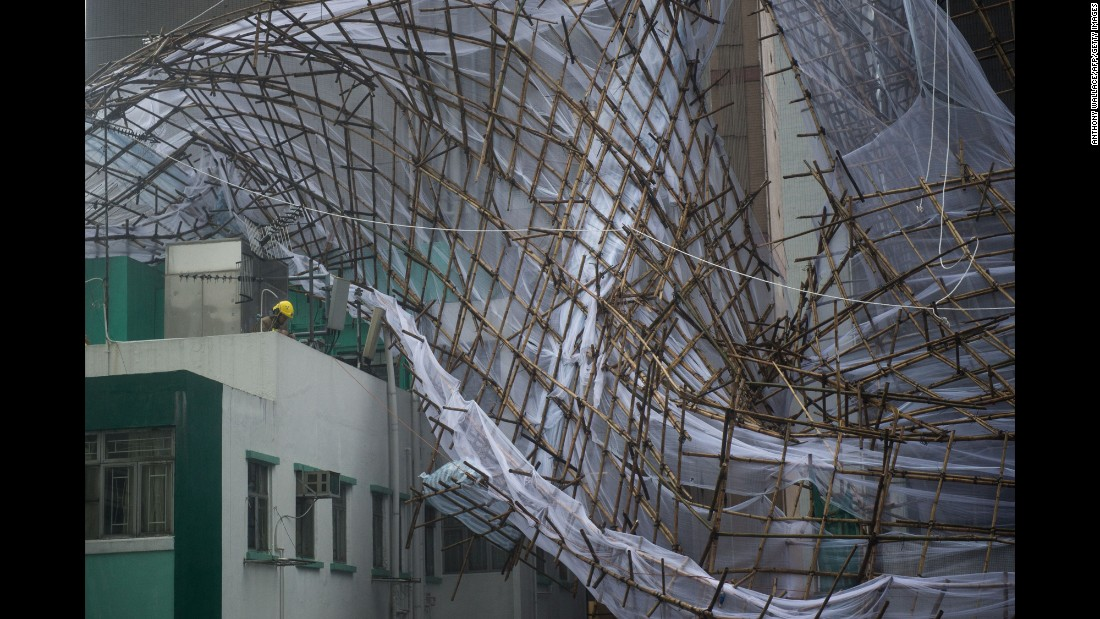 "Rescue workers attempt to secure bamboo scaffolding that was damaged during a storm in Hong Kong on Tuesday, August 2. <a href=""http://www.cnn.com/2016/08/01/asia/typhoon-nida-hong-kong-guangzhou/"" target=""_blank"">Typhoon Nida</a> hit the city and moved onto mainland China."