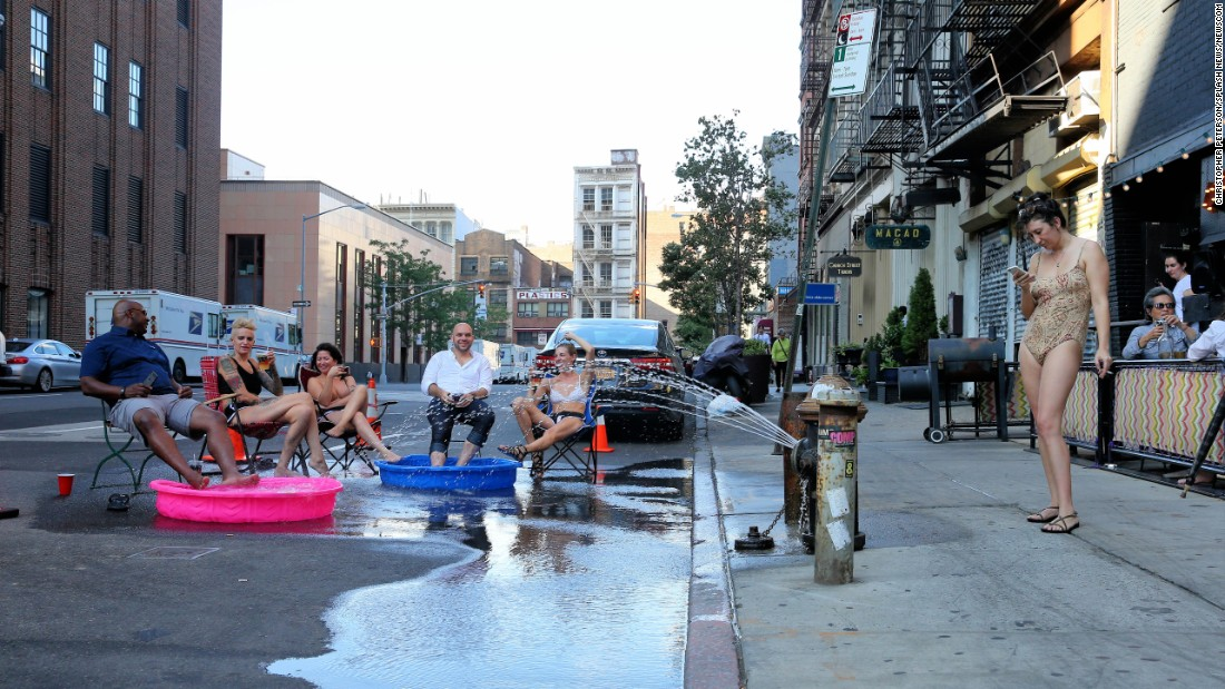 New Yorkers try to beat the summer heat on Sunday, August 14.