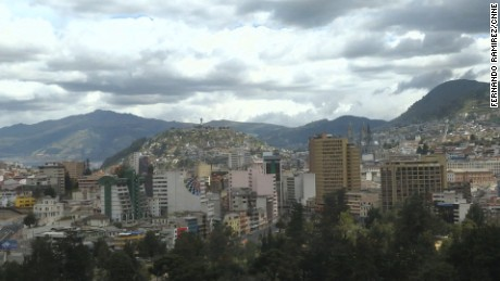 ####2015-07-05 00:00:00 07/05/2015 ## Quito beauty shots: Skylines, town square, statues, street scenes, pedestrian traffic, police, roman catholic church interior.
