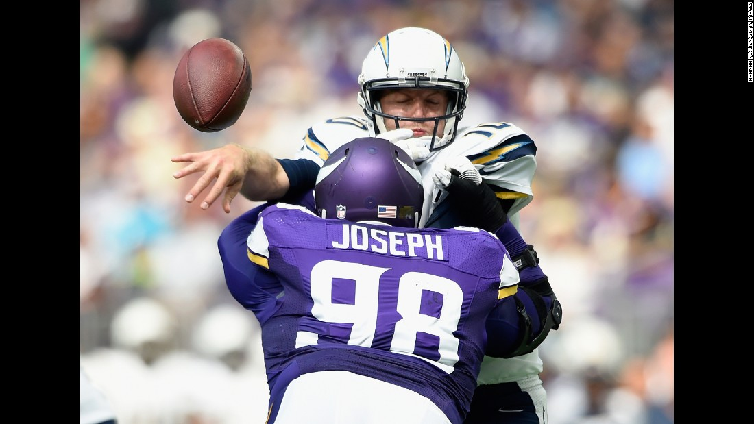 Minnesota's Linval Joseph hits San Diego quarterback Kellen Clemens during an NFL preseason game in Minneapolis on Sunday, August 28.