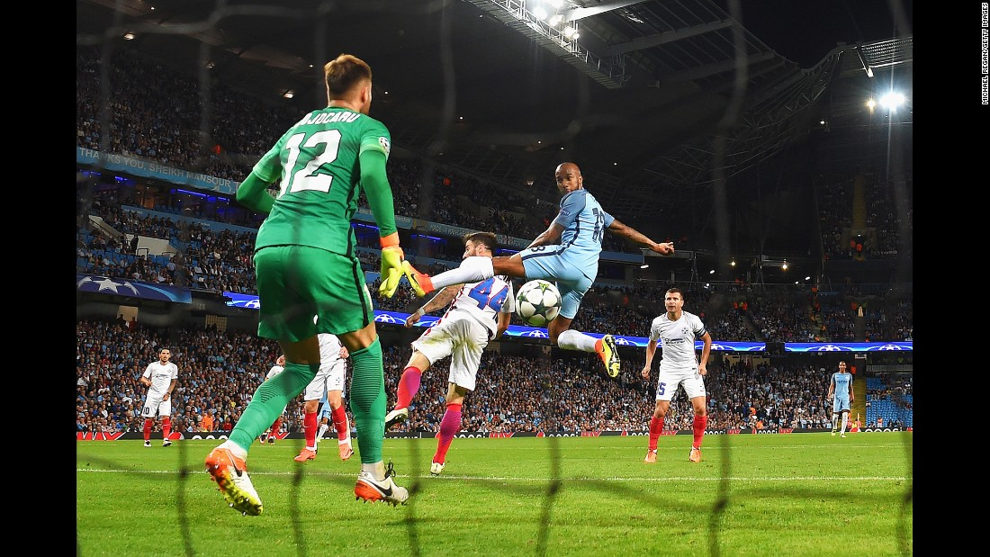 Manchester City midfielder Fabian Delph, in blue, scores the only goal of a Champions League playoff match with Steaua Bucharest on Wednesday, August 24. The English club defeated Steaua 6-0 over two legs to clinch a spot in the tournament's group stage.
