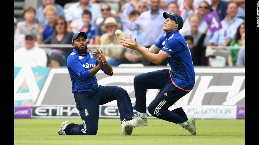 English cricketer Joe Root, right, crashes into teammate Adil Rashid as he catches a ball against Pakistan on Saturday, August 27. England won by four wickets in the one-day international.