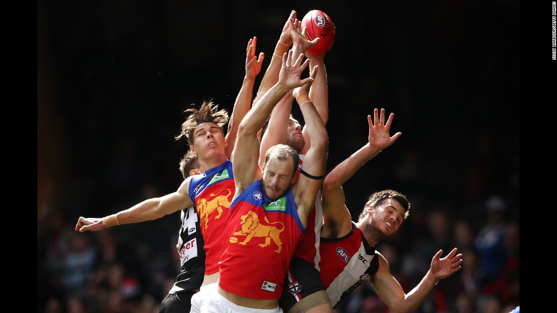 Players compete for the ball during an Australian Football League match between the St. Kilda Saints and the Brisbane Lions on Sunday, August 28.
