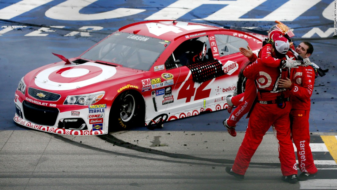 NASCAR driver Kyle Larson celebrates with crew members after winning the Sprint Cup race at Michigan International Speedway on Sunday, August 28. It was the first victory of his Sprint Cup career.