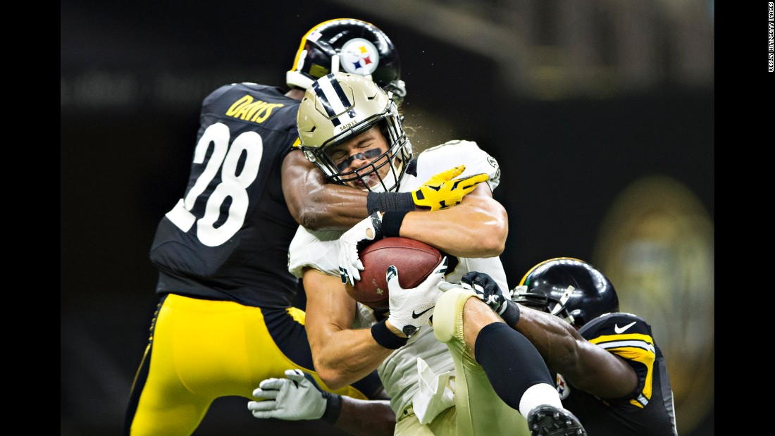 New Orleans tight end Coby Fleener is hit by two Pittsburgh Steelers during an NFL preseason game on Friday, August 26.