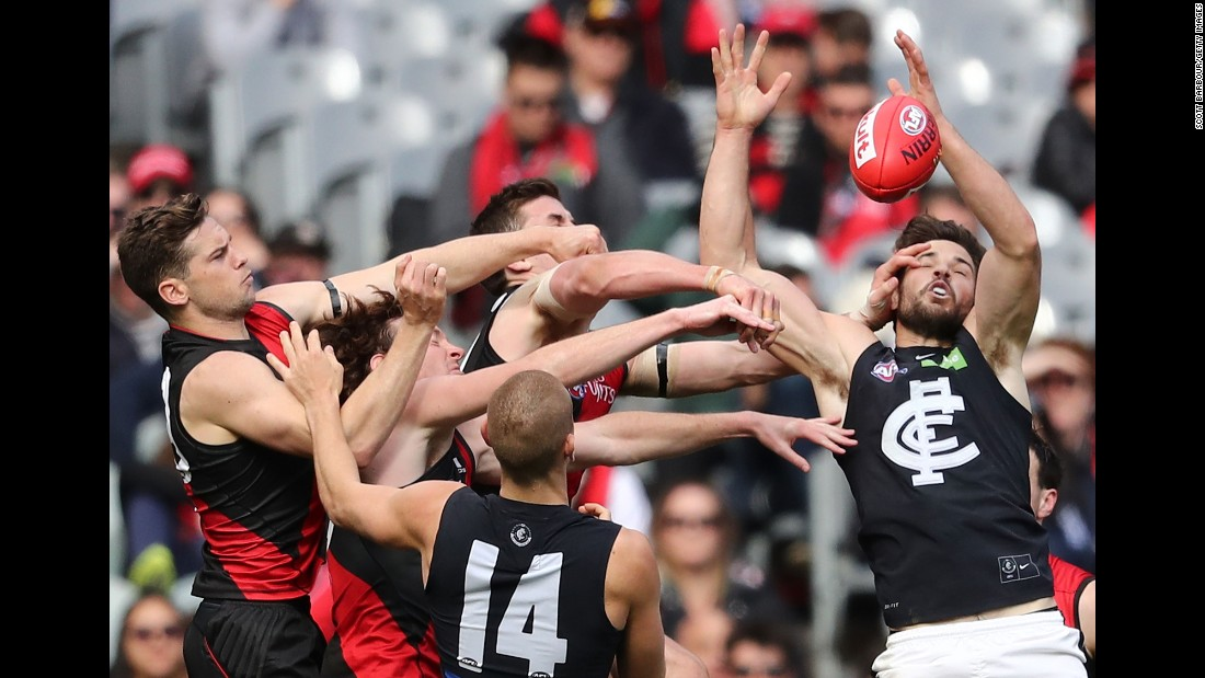 Players fight for the ball during an Australian Football League match between the Essendon Bombers and the Carlton Blues on Saturday, August 27.