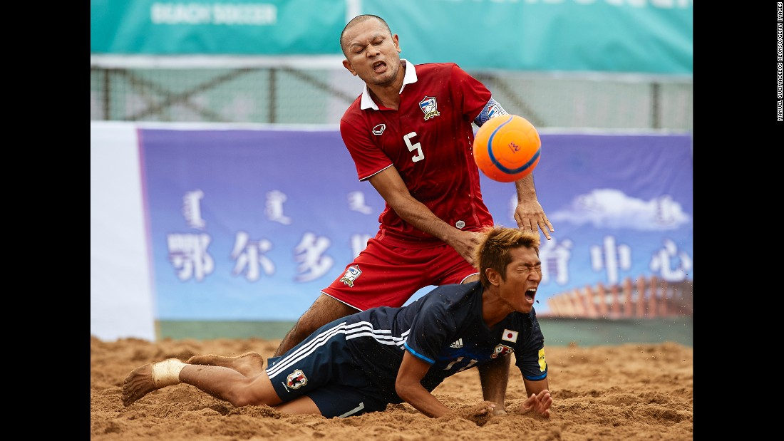 "Japan's Takasuke Goto, bottom, is tackled by Thailand's Pongsak Khongkaew during a beach soccer match in China on Tuesday, August 23. <a href=""http://www.cnn.com/2016/08/23/sport/gallery/what-a-shot-olympics-0823/index.html"" target=""_blank"">See 51 amazing Olympic photos from last week</a>"