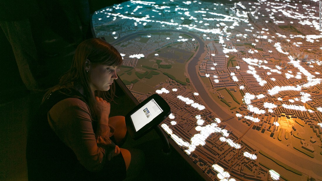 The model illustrates London's architectural development through detailed artistry, projections and interactive films.