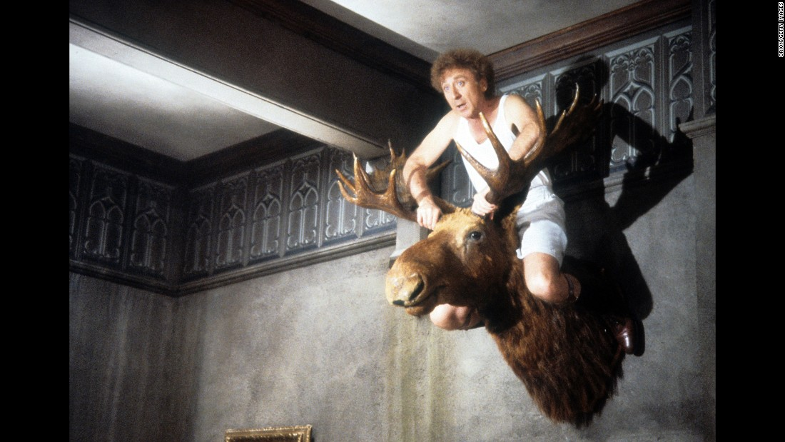 "Wilder sits atop a mounted moose head in a scene from ""Haunted Hollywood,"" a film he directed in 1986."