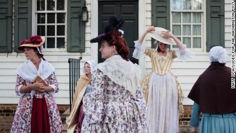 Living historians at Colonial Williamsburg prepare for a depiction of 18th century life.