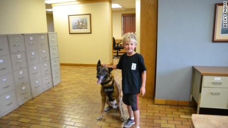 Ethan Engum poses with a police dog at K9 training.