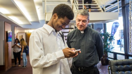 Father Stephen Katsouros, right, is dean and executive director of Arrupe College of Loyola University Chicago.
