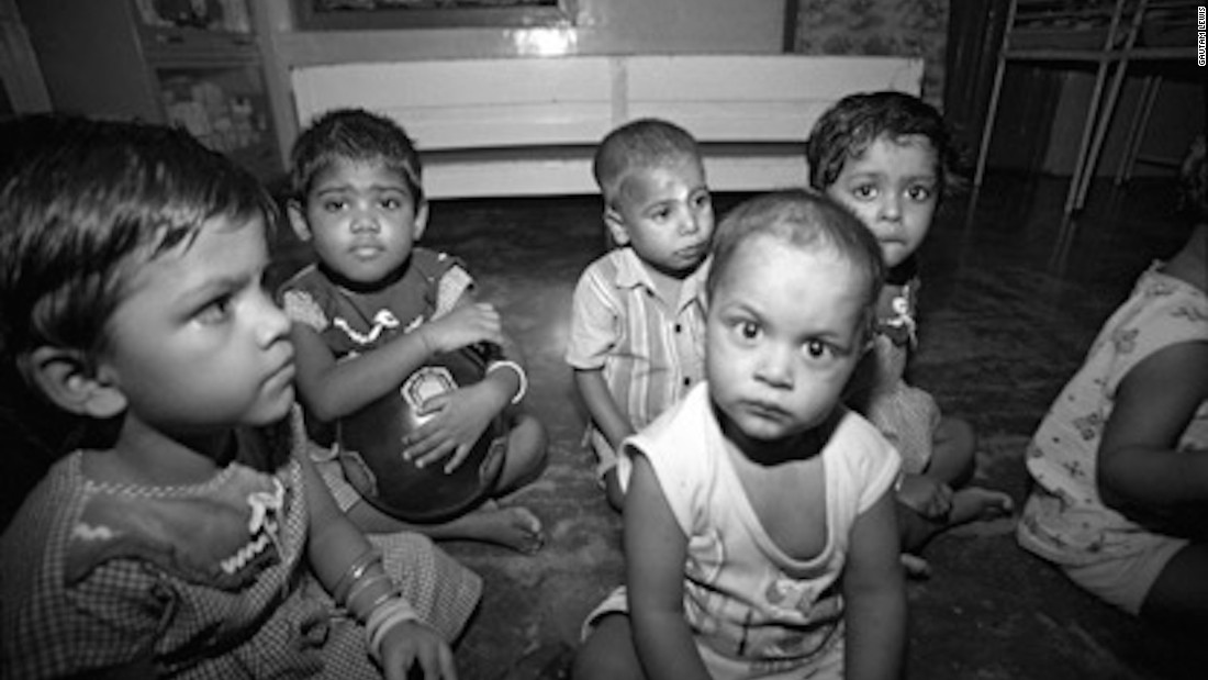 "These orphans, photographed by Gautam in 2009, were rescued by the Missionaries of Charity and taken to Shishu Bhavan. Gautam says the time he spent at the home was tough.  ""My memories from that period are dark, sad, and lonely,"" he says."