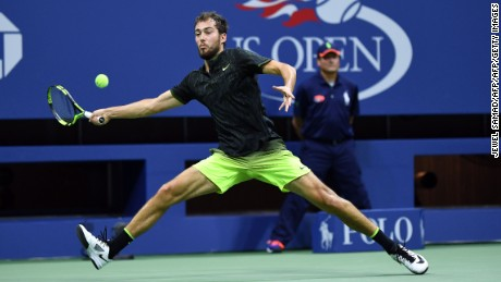Jerzy Janowicz of Poland hits a return against Novak Djokovic of Serbia during their 2016 US Open Men's Singles match at the USTA Billie Jean King National Tennis Center in New York on August 29, 2016. / AFP / Jewel SAMAD        (Photo credit should read JEWEL SAMAD/AFP/Getty Images)