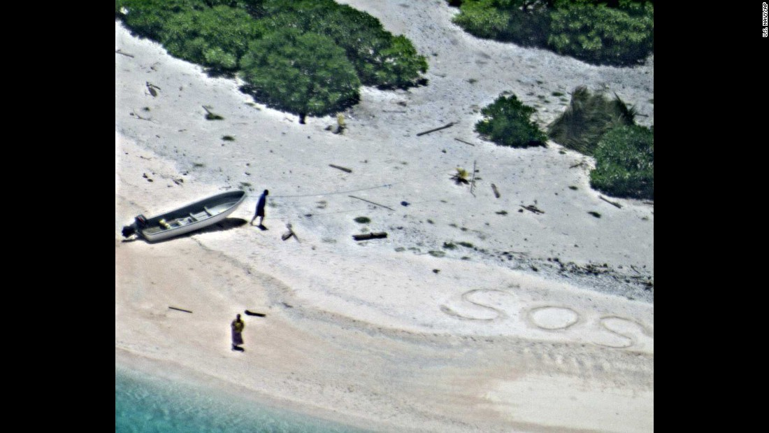 "Two stranded mariners signal for help as a U.S. Navy aircraft passes over a deserted beach in Micronesia on Thursday, August 25. The Coast Guard <a href=""http://www.cnn.com/2016/08/27/us/sos-rescue-from-island/"" target=""_blank"">rescued the mariners,</a> who were marooned for eight days."