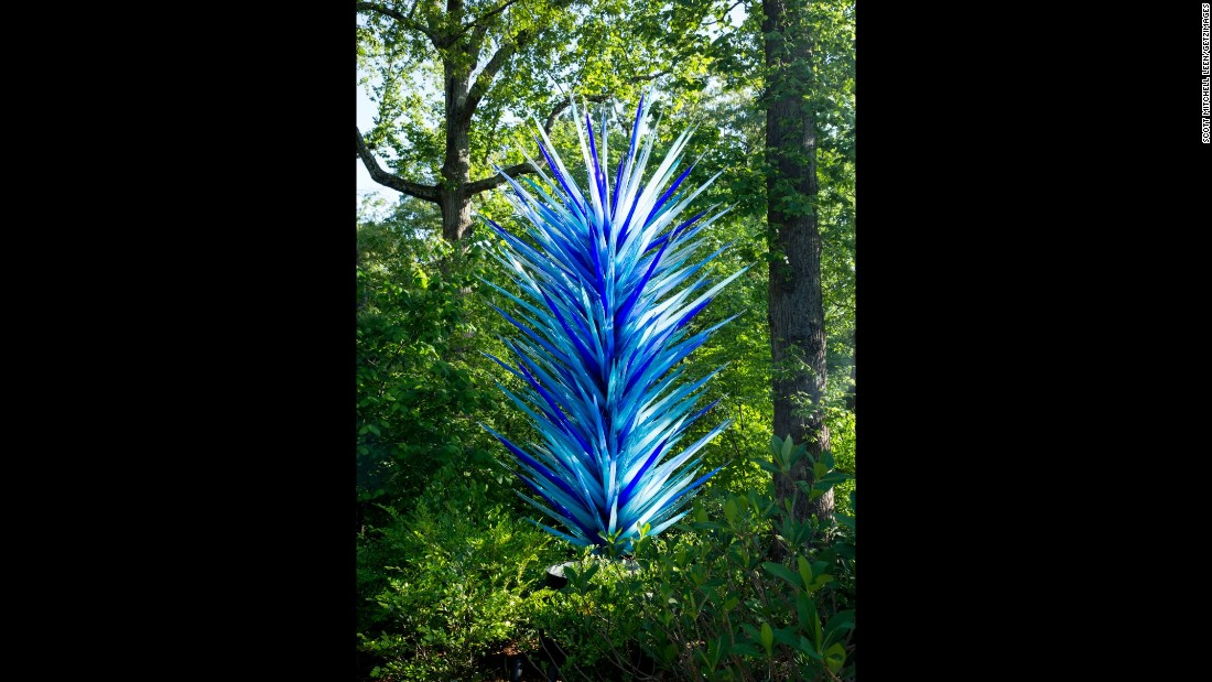 "The ""Indigo Blue Icicle Tower,"" which was created for the current exhibition, greets visitors to the garden."