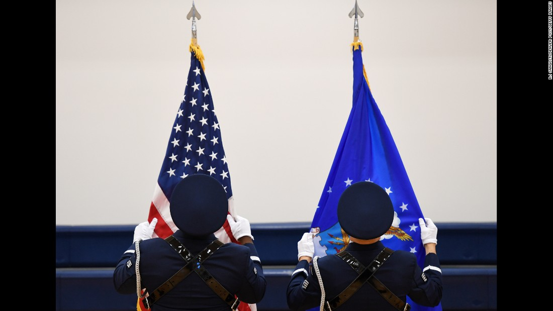 Honor guard members from the U.S. Air Force prepare flags for a change-of-command ceremony at Colorado's Buckley Air Force Base on Friday, August 12.