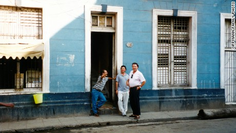 Then: Patrick Oppmann, center, his father and a Cuban resident in 1994.